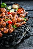Tasty grilled chicken leg with sauces and lime Stock Photos