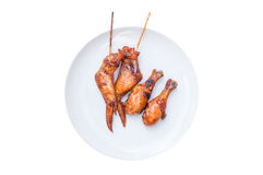 Tasty grilled chicken wings skewers and chicken leg isolated on white Stock Images