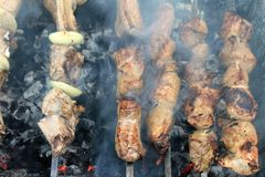 Tasty grilled meat on skewers Royalty Free Stock Photo