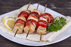 Tasty grilled meat and vegetables on skewer . Close up Royalty Free Stock Photo