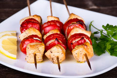 Tasty grilled meat and vegetables on skewer Stock Images