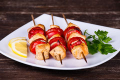 Tasty grilled meat and vegetables on skewer Stock Photography