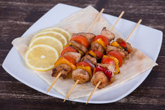 Tasty grilled meat and vegetables on skewer Royalty Free Stock Images