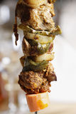Tasty grilled meat and vegetables on skewer Stock Image
