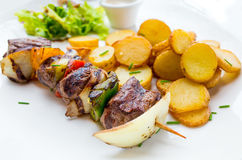 Tasty grilled meat and vegetables skewers Stock Photos