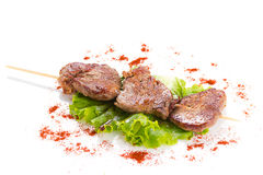 Tasty grilled meat and vegetables on skewers Stock Photography