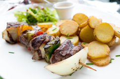 Tasty grilled meat and vegetables skewers Royalty Free Stock Images