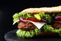 Tasty grilled prawn and beef burger with lettuce and tomato stock image
