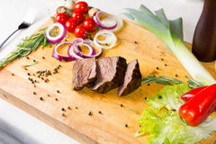 Tasty Grilled Tender Meat Slices on Wooden Board Stock Images