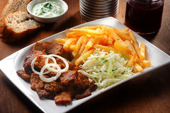 Tasty Gyros, Cabbage and Fries on White Plate Royalty Free Stock Photography