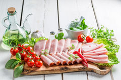 Tasty ham with herbs and pepper Stock Images