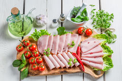 Tasty ham with pepper and herbs Stock Images