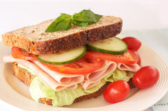Tasty ham, tomato and cucumber sandwich Stock Photography