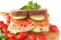 Tasty ham, tomato and cucumber sandwich. Tasty smoked ham, tomato and cucumber sandwich on wholewheat bread Royalty Free Stock Images