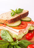 Tasty ham, tomato and cucumber sandwich Stock Photo