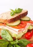 Tasty ham, tomato and cucumber sandwich. Tasty smoked ham, tomato and cucumber sandwich on wholewheat bread Stock Photo