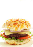 Tasty hamburger. With grilled patty, tomato, cheese and lettuce on white background Royalty Free Stock Images