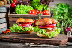 Tasty hamburger with beef and cheese. On old wooden table Stock Photography