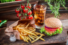Tasty hamburger with cold drink and fries Royalty Free Stock Photography