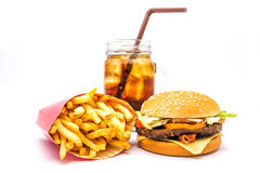 Tasty hamburger, French fries and cola isolated on white background. Tasty hamburger, French fries and cola isolated on white background, Fast food Royalty Free Stock Photos