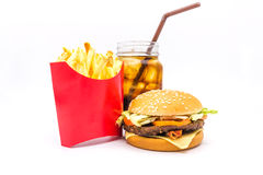 Tasty hamburger, French fries and cola isolated on white background. Tasty hamburger, French fries and cola isolated on white background, Fast food Royalty Free Stock Image