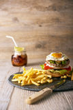 Tasty hamburger with french fries, selective focus Stock Photo