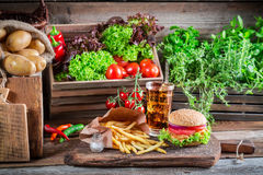 Tasty hamburger with fries and cold drink Stock Photos