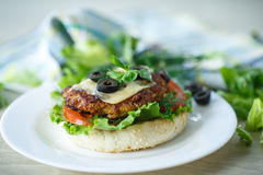 Tasty hamburger with lettuce and tomato Royalty Free Stock Image