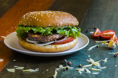 Tasty hamburger. With meat cutlet and fresh herbs Royalty Free Stock Photography