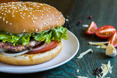 Tasty hamburger. With meat cutlet and fresh herbs Stock Image