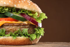 Tasty hamburger on wood background Royalty Free Stock Photos
