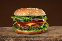 Tasty hamburger on wood background Stock Photo