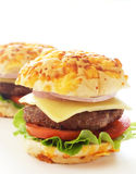Tasty hamburgers. With grilled patty, tomato, cheese and lettuce on white background Royalty Free Stock Image