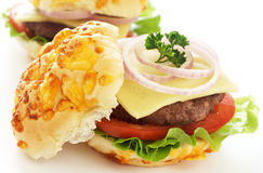 Tasty hamburgers. With grilled patty, tomato, cheese and lettuce on white background Stock Photo