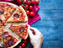 Tasty Hand Made Tomatoes and Pepperoni Pizza Stock Photo
