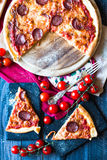 Tasty Hand Made Tomatoes and Pepperoni Pizza Stock Images