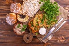 Tasty Hanukkah celebration food on vintage cutting board royalty free stock photo