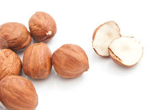 Tasty hazelnuts on white. Some delicious hazelnuts closeup on white background stock photography