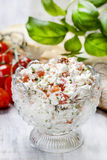 Tasty and healthy breakfast: bowl of cottage and tomato salad Royalty Free Stock Image
