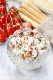 Tasty and healthy breakfast: bowl of cottage and tomato salad Royalty Free Stock Images