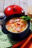 Tasty Healthy Creamy Soup with Sausage on Pot Stock Image