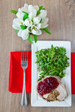 Tasty And Healthy Dinner. Meat baked with mushrooms under cowberry jam, served with ruccola royalty free stock photos