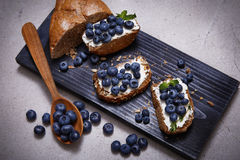 Tasty healthy food bread cream cheese blueberry juicy organic Stock Images