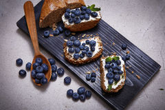 Tasty healthy food bread cream cheese blueberry juicy organic Royalty Free Stock Images