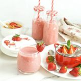 Tasty and healthy food for breakfast and snack with fresh strawberries. Yogurt with strawberries, smoothies, rice waffles, cornflakes, milk. copy space stock photos