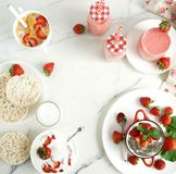 Tasty and healthy food for breakfast and snack with fresh strawberries. Tasty and healthy food for breakfast and snack with fresh strawberries top view. Yogurt stock image