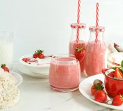 Tasty and healthy food for breakfast and snack with fresh strawberries. Yogurt with strawberries, smoothies, rice waffles, cornflakes, milk. copy space royalty free stock photos