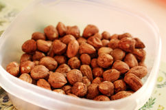 Tasty and healthy hazelnuts in the bowl. Photo of tasty and healthy hazelnuts in the bowl stock images