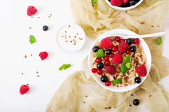 Tasty and healthy oatmeal porridge with berry, flax seeds and yogurt. Royalty Free Stock Image