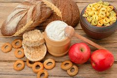 Tasty and healthy products and breads on table royalty free stock photo